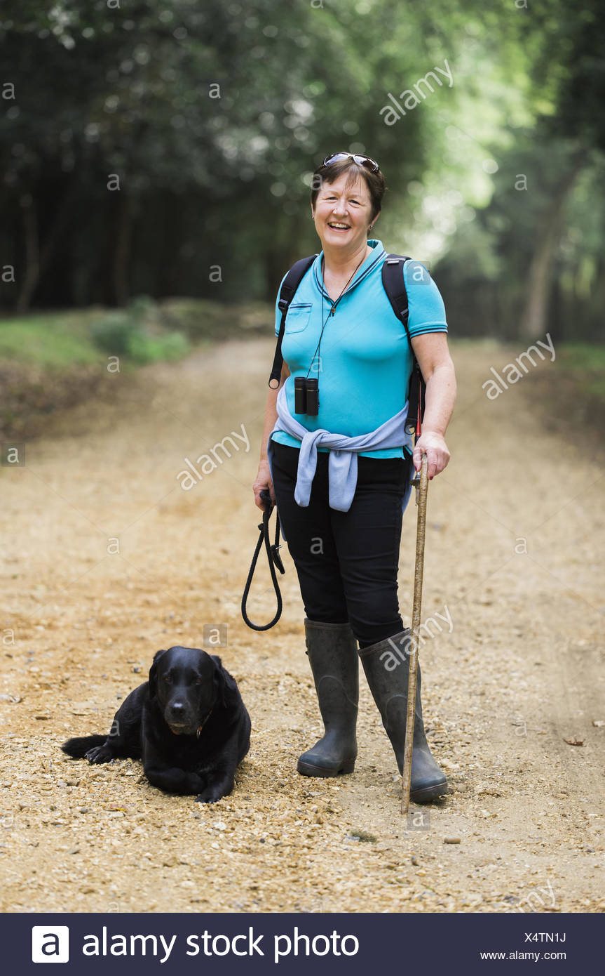 Female hiker with her dog. - Stock Image