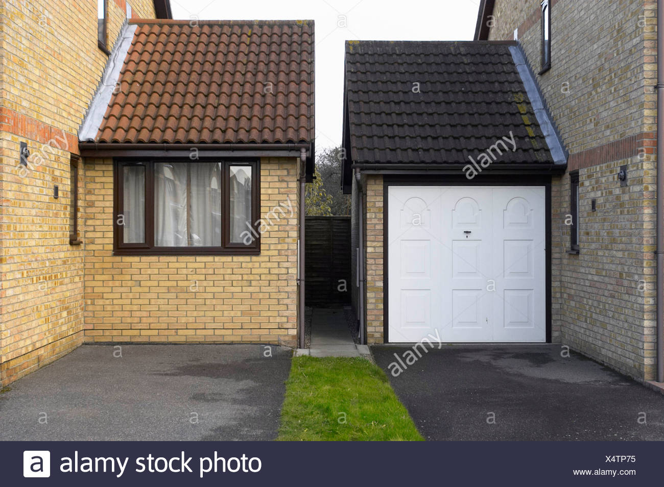 New Garage Extension And Entrance On A Side Of Houses Stock Photo