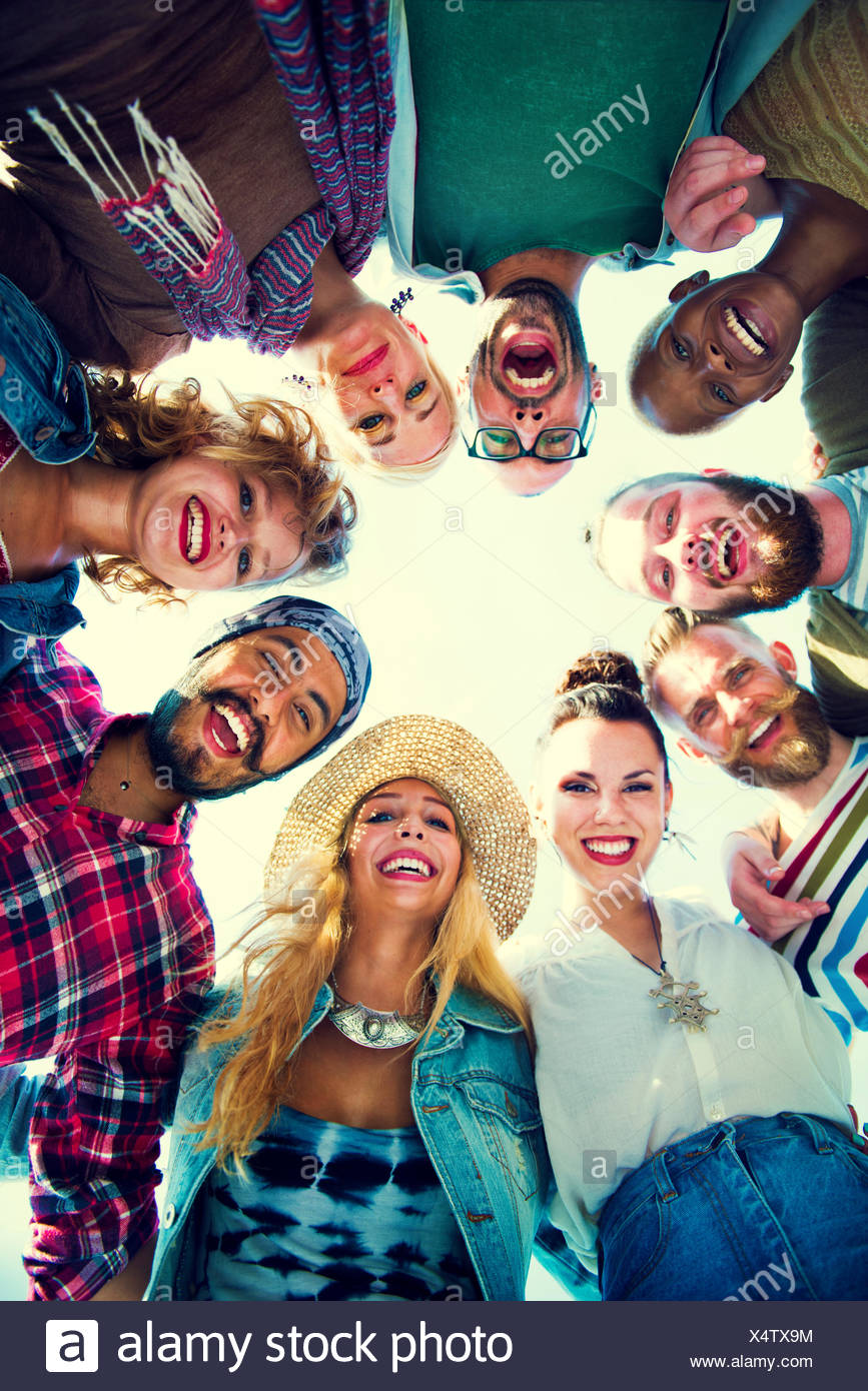 Friends Huddle Join Holiday Party Group Concept - Stock Image