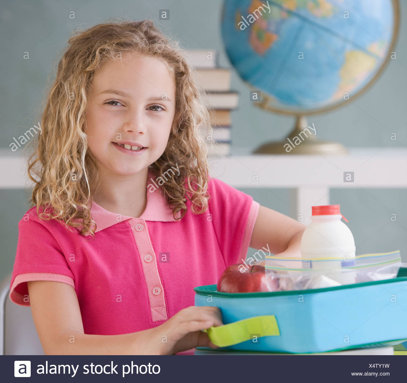 Girl eating lunch at school - Stock Image