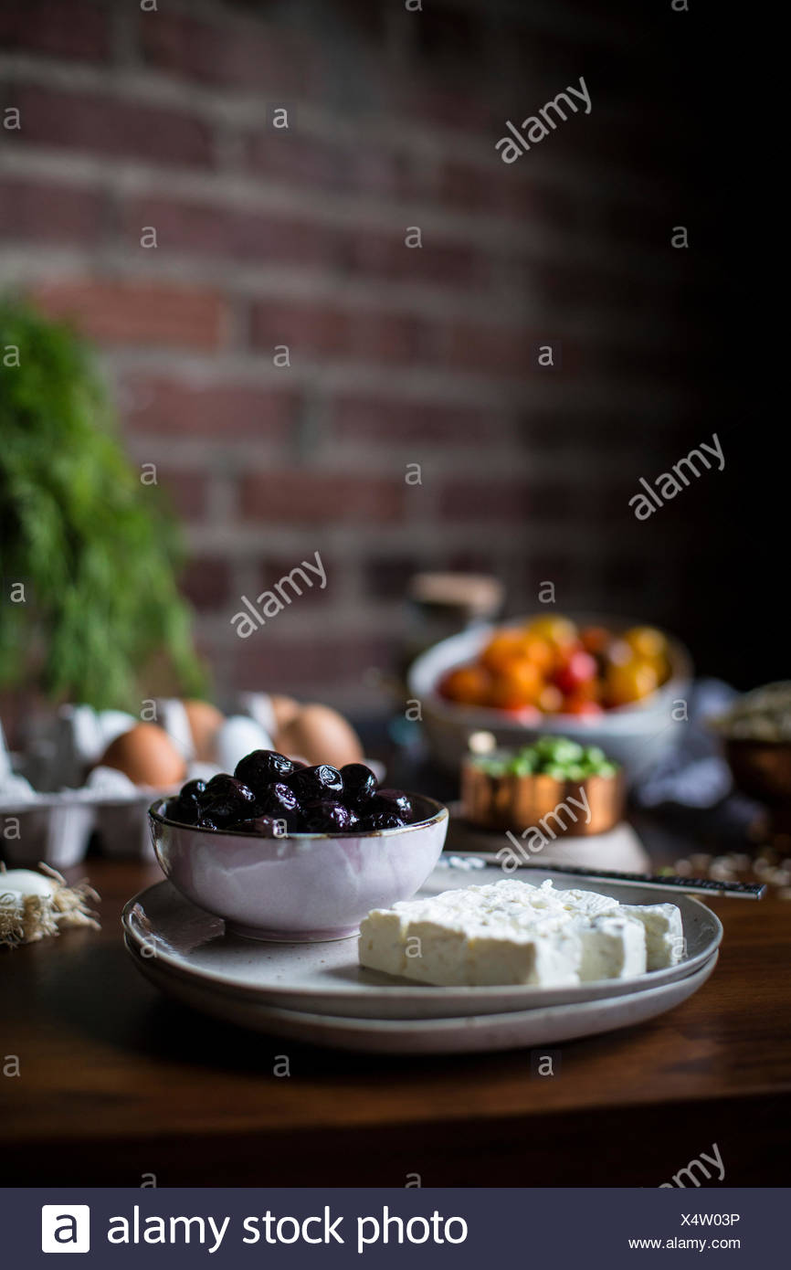 Orzo salad ingredients are photographed from the front. - Stock Image