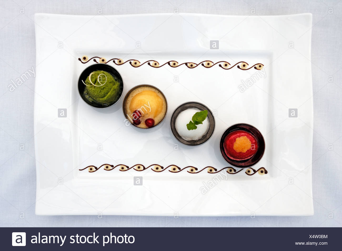 Various sorbets on a white plate, Haute Cuisine, Auberge de la Ferme Hueb, Mike Germershausen, Marckolsheim, Alsace, France - Stock Image