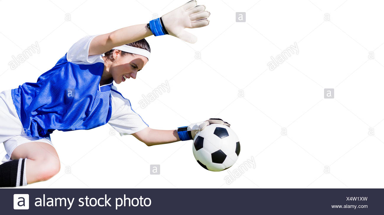 Woman goalkeeper stopping a goal - Stock Image