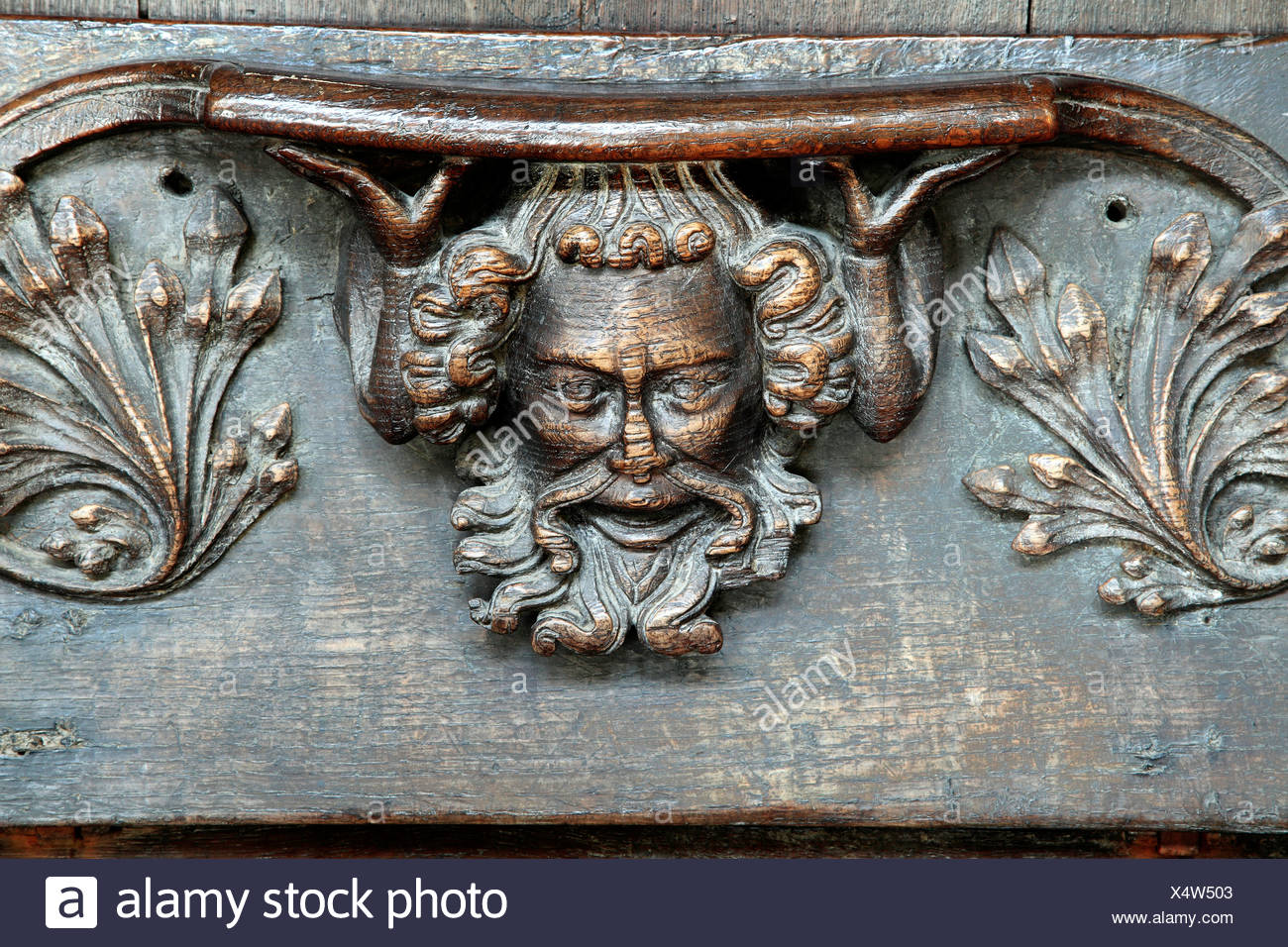 14th century medieval misericord, bearded man supporting seat, St. Margarets, Kings Lynn Norfolk England UK English misericords - Stock Image