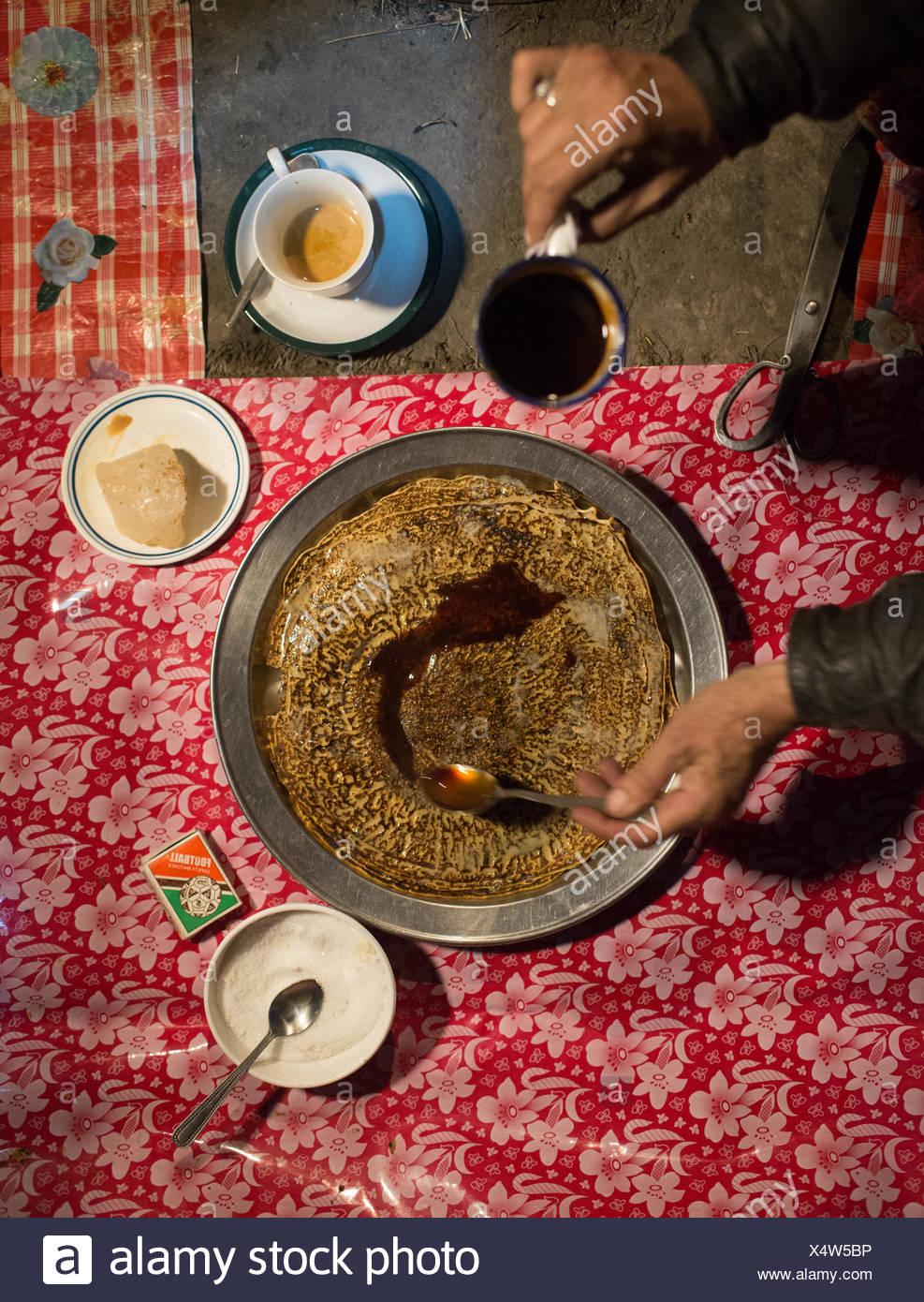 A woman cooks a meal of Maltashtze Giyaling, Hunza pancakes. - Stock Image
