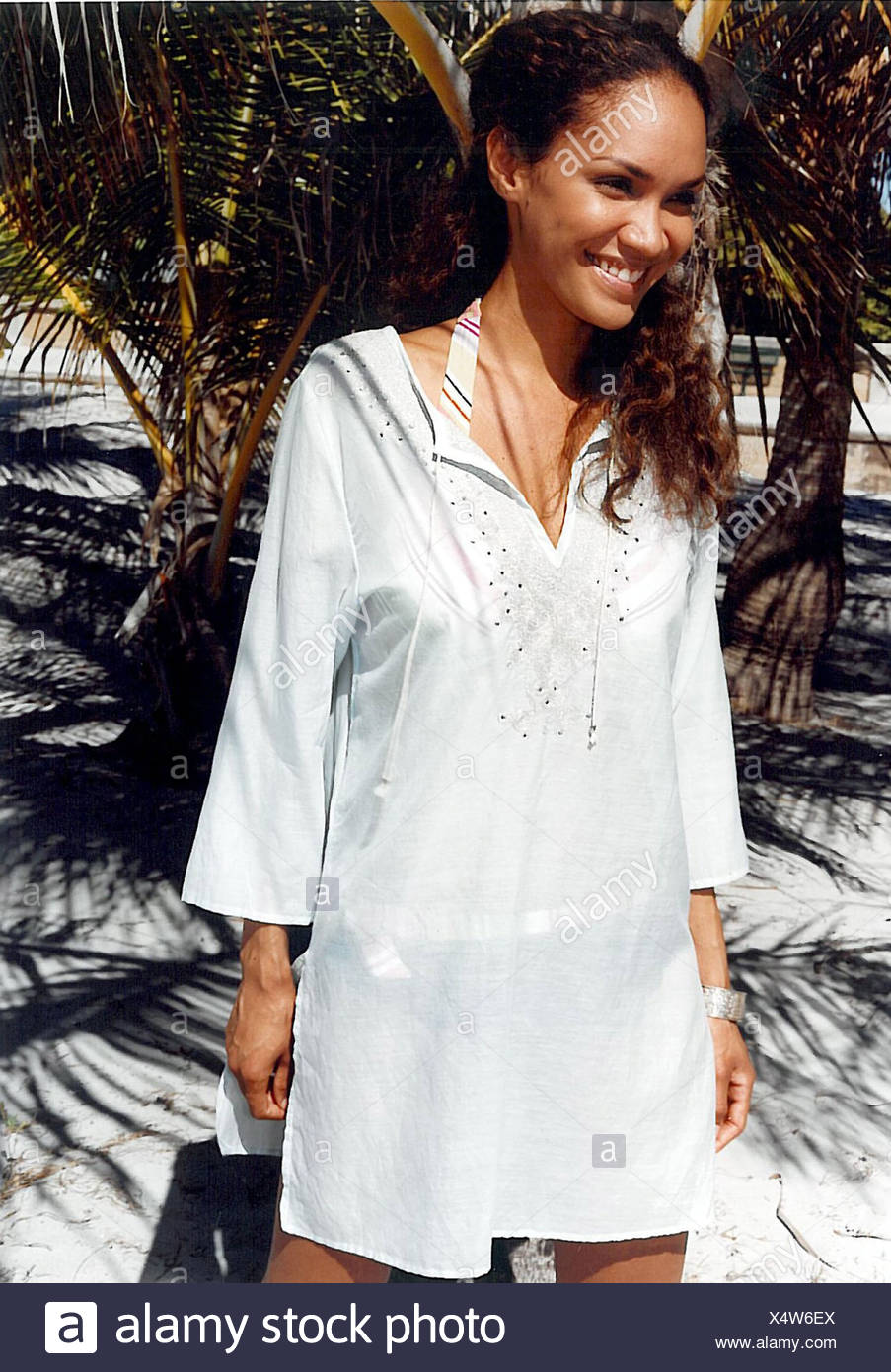 d4cc58a8c6c00 Female wearing white kaftan top over a bikini Frowein Stock Photo ...
