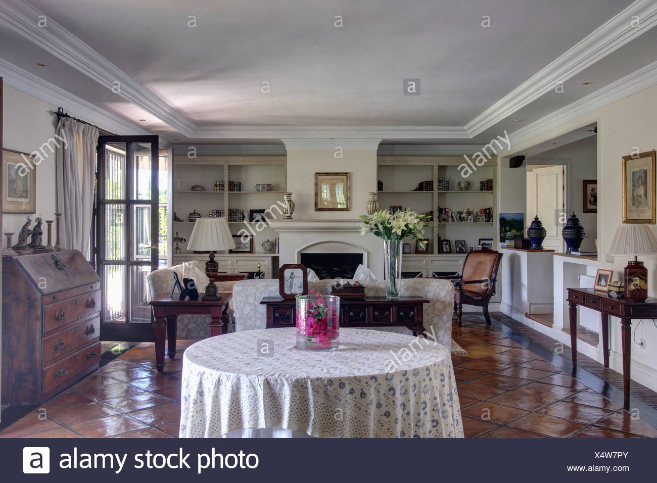 White cloth on circular table in traditional Spanish ...