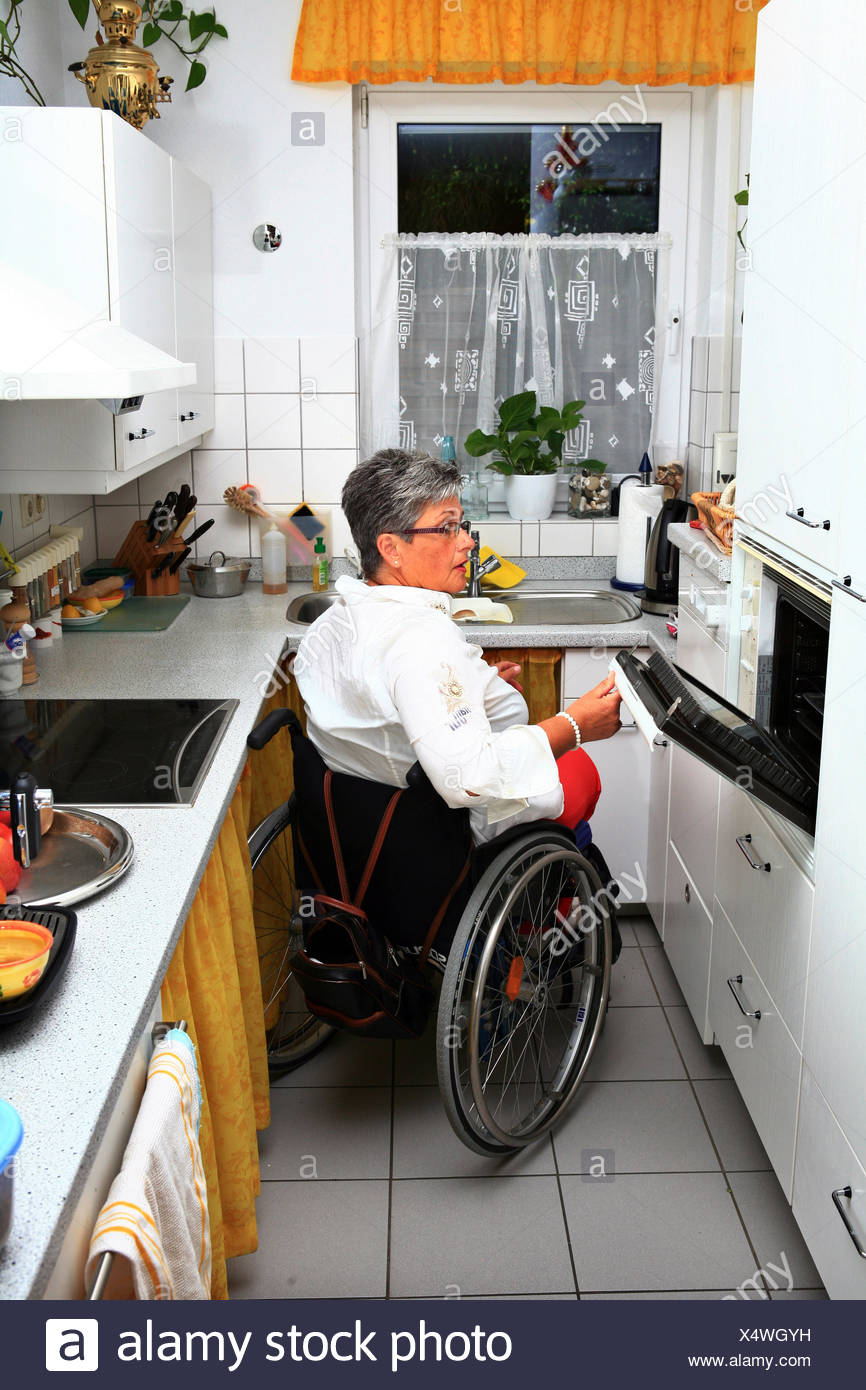 Woman In Wheelchair In Their Accessible Kitchen Stock Photo Alamy