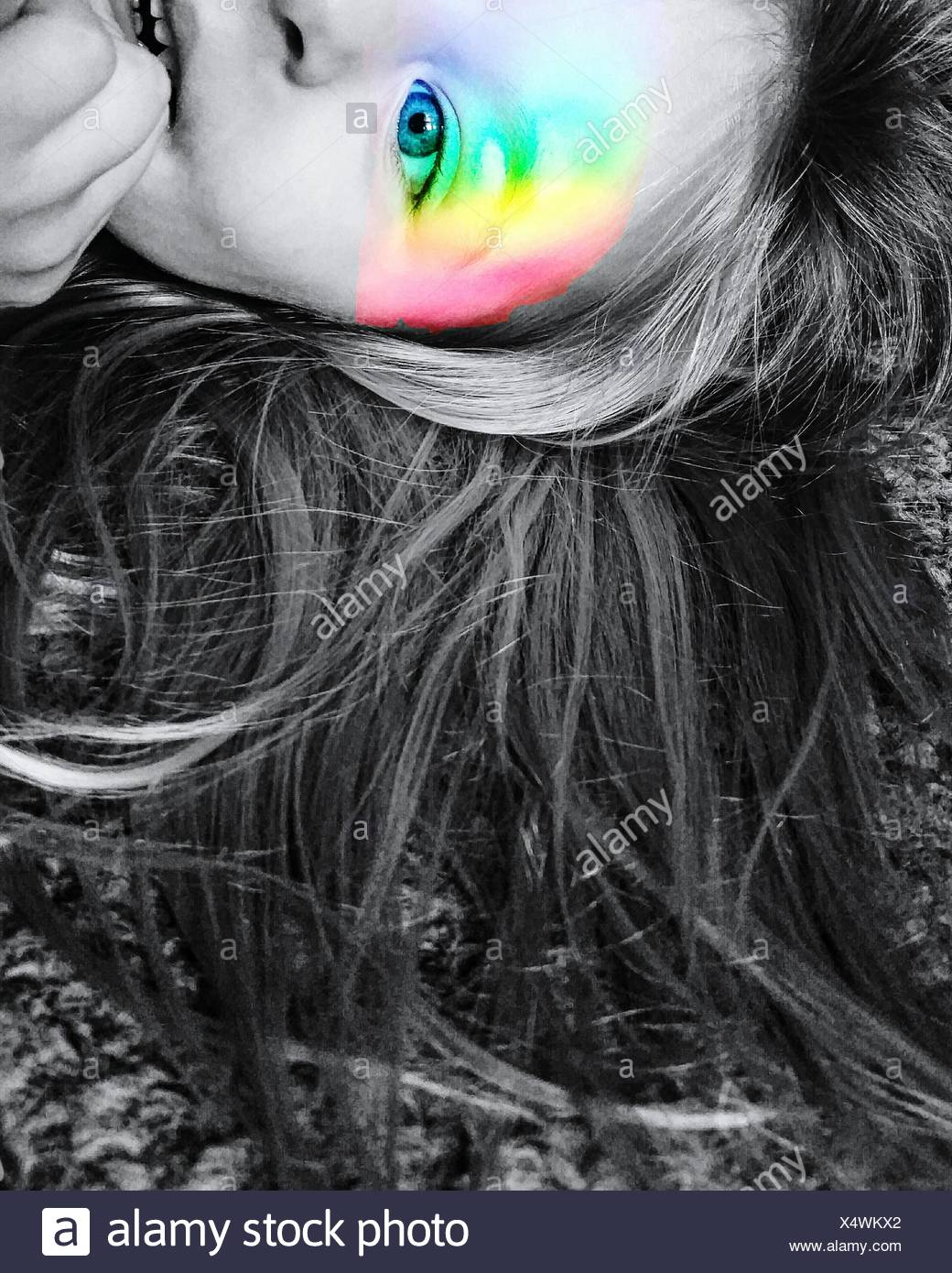 Digital Composite Image Of Girl With Rainbow Color Flash On Face - Stock Image