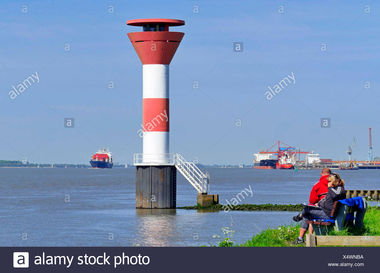 leading lights Buetzeflether Sand, container ship in background, Germany, Lower Saxony, Elbe, Stade Stock Photo