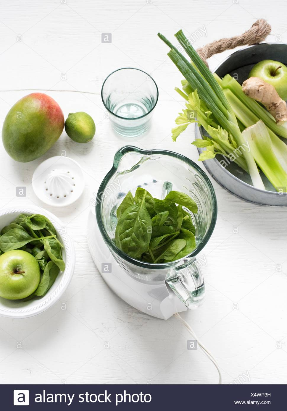 Blender with fresh green fruits and vegetables Stock Photo