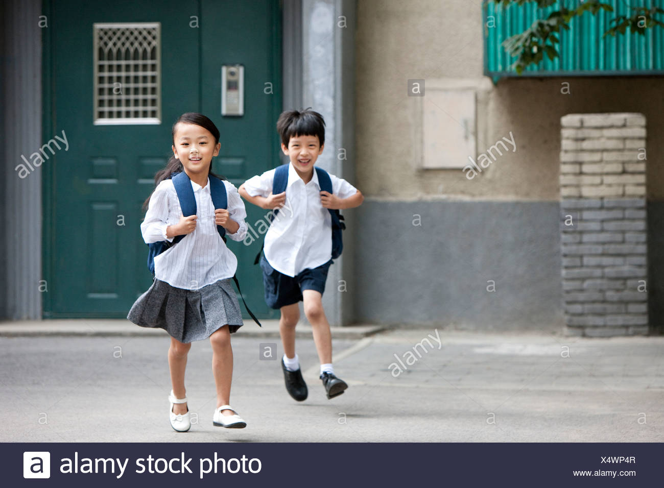 Children running to school - Stock Image