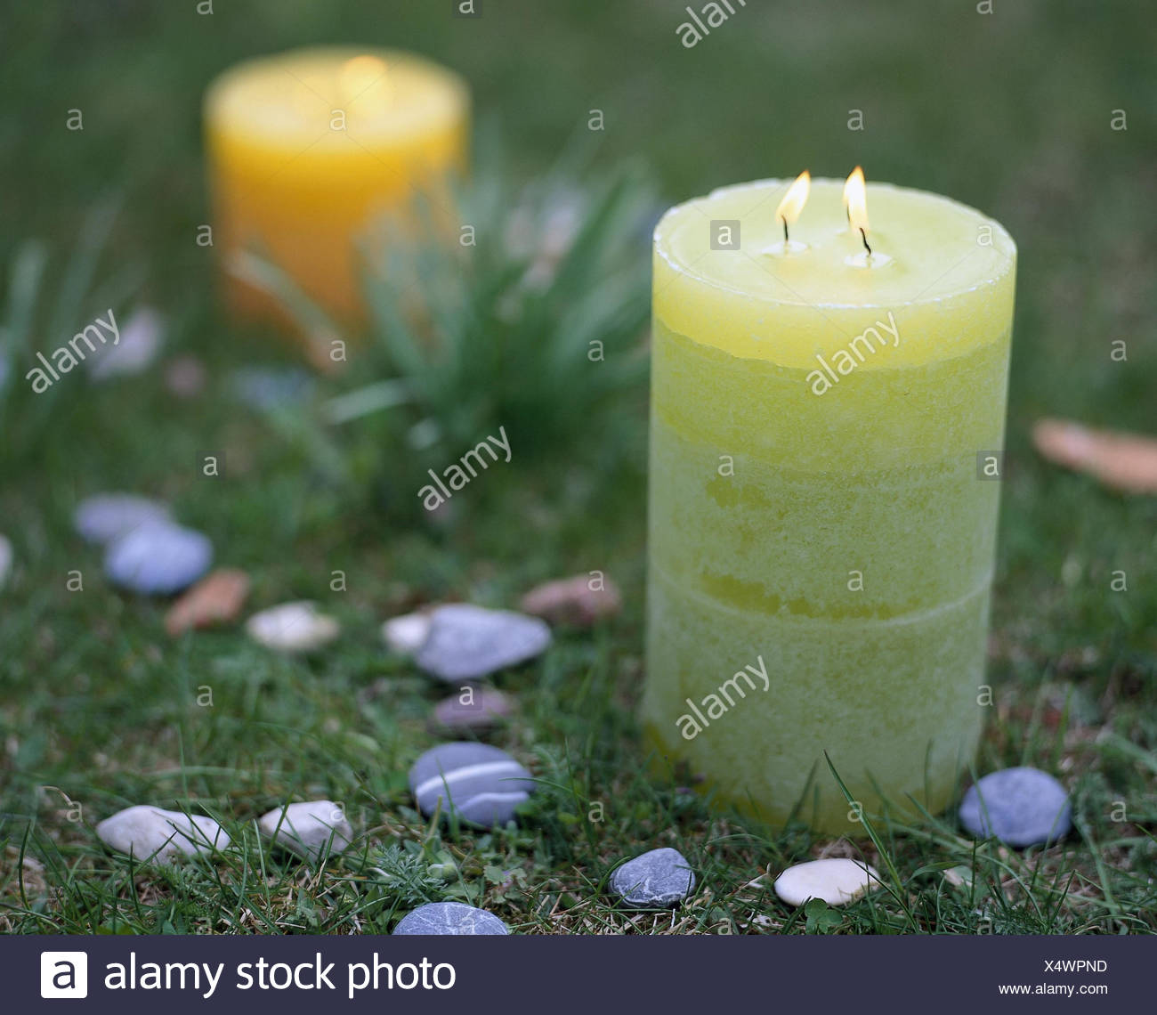 Meadow, candles, blast, stone circles, Still life, candle, odour candles, flames, light, candle light, lighted, colour, passed away, grass, Esotherik, mysticism, Feng Shui, circles, wicks, colourfully, differently, wax candles, symbolism, lighting, stones - Stock Image
