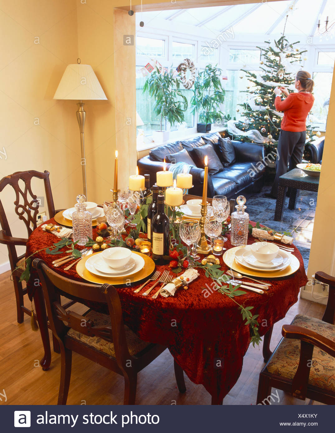 Table Decorated And Set For Christmas Dinner In Traditional Dining