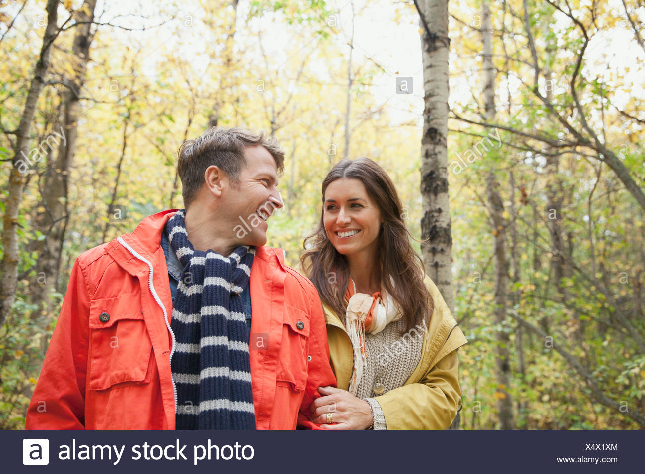 Happy couple walking in park - Stock Image