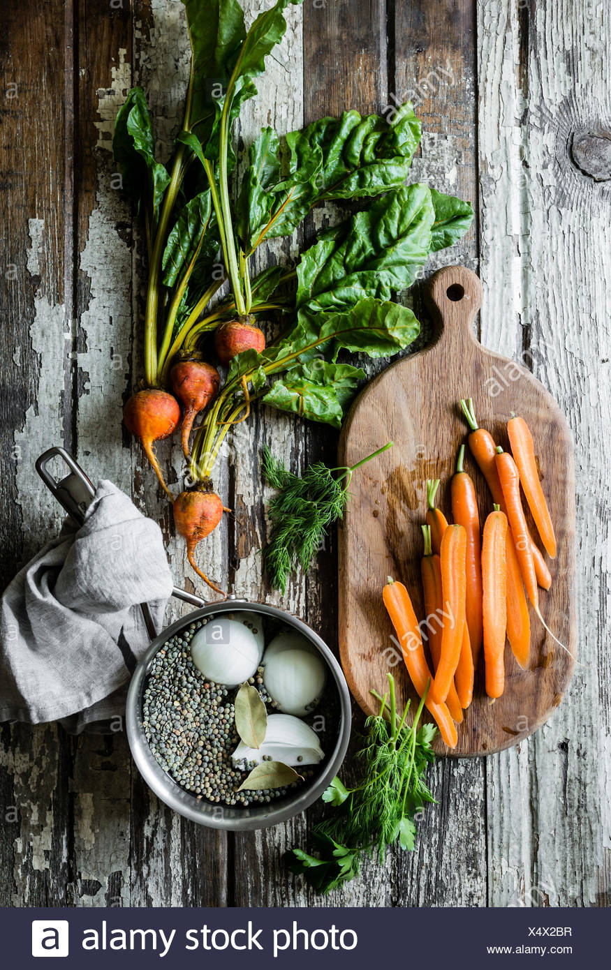 Carrots, beets and lentils on a vintage wooden table background - Stock Image