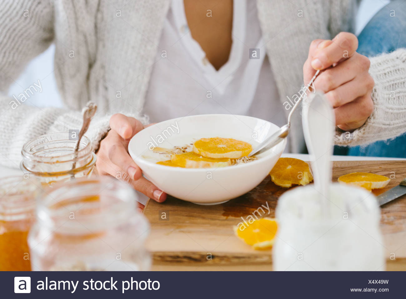 Woman having muesli and fruit - Stock Image