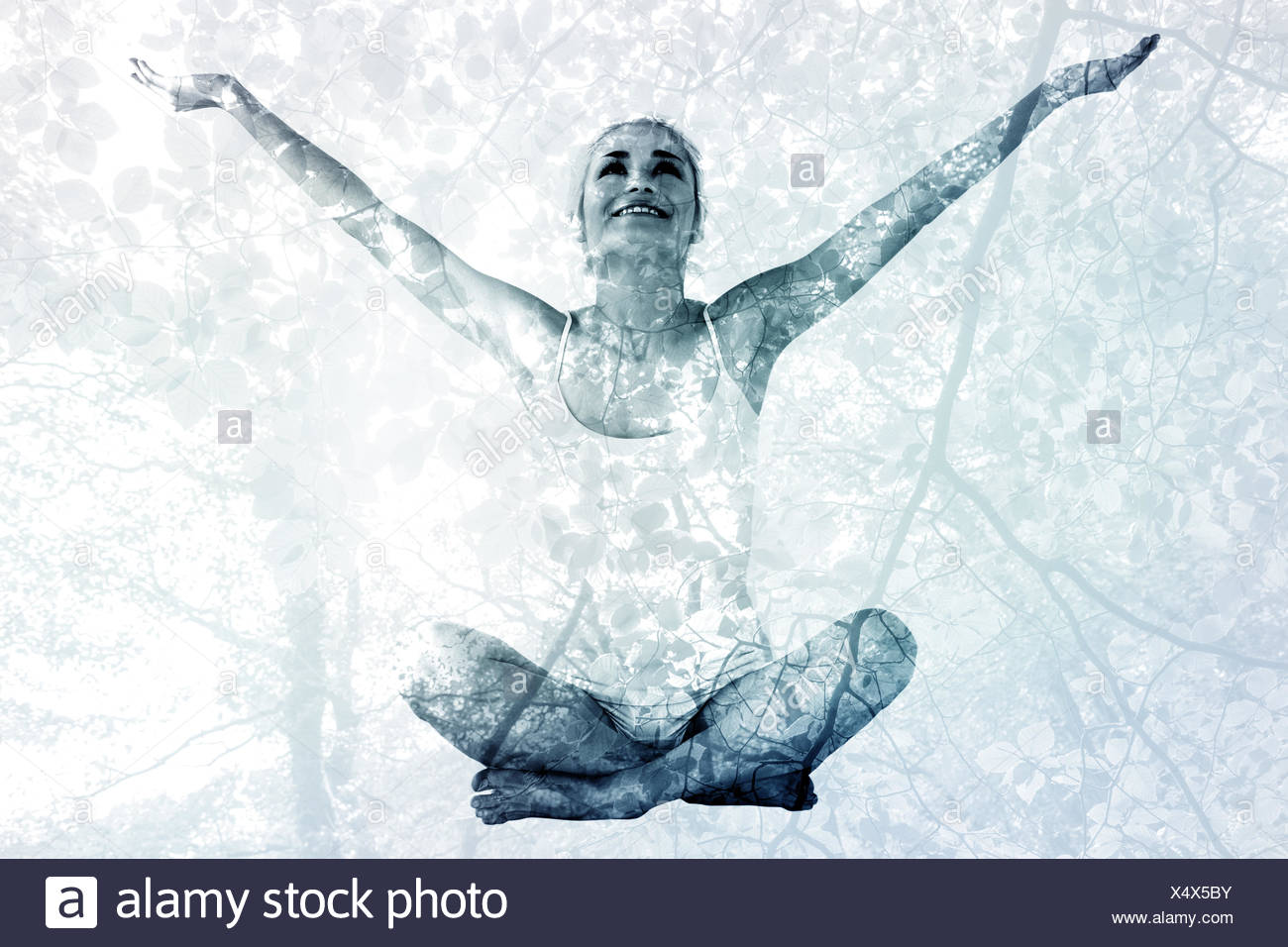 Composite image of toned young woman sitting with arms outstretched - Stock Image