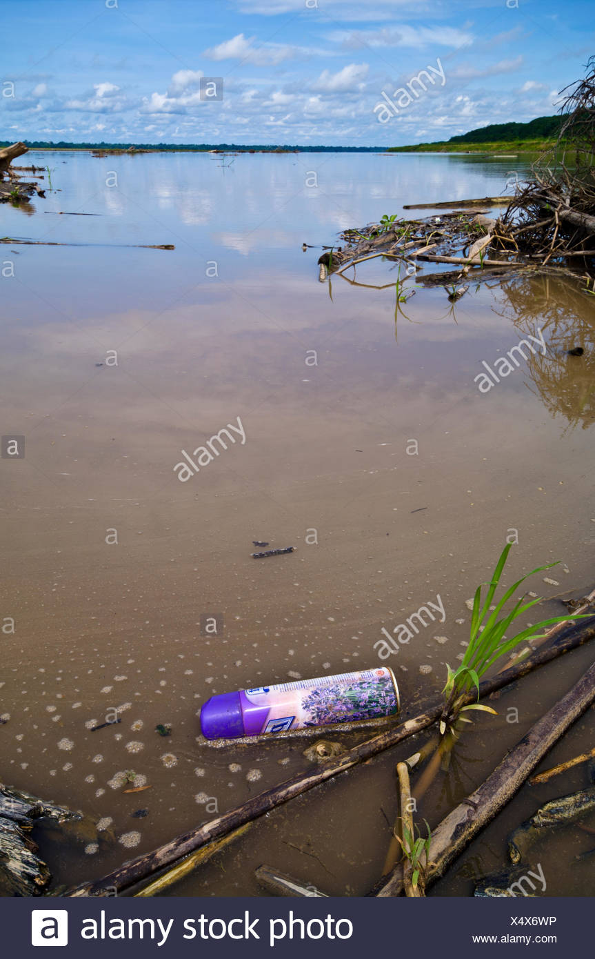 An aerosol spray can polluting the waters of the Amazon River. - Stock Image