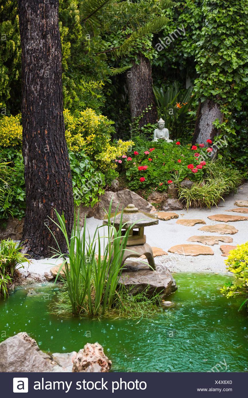 Spain Europe Home Garden Rainy Buddha Design Drops Flowers