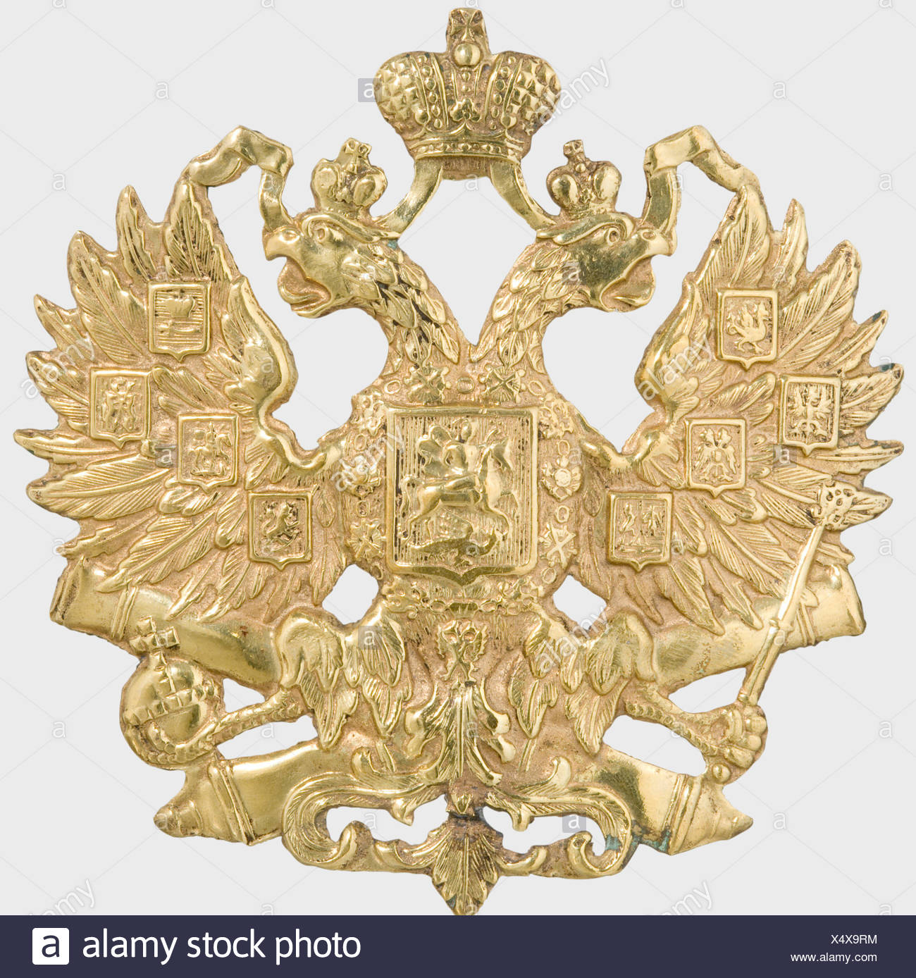 A helmet emblem, of the Imperial Russian Army Sheet brass with the gilding mostly preserved. The loops on the back were repositioned during the period it was worn. historic, historical, 19th century, fine arts, art, art object, art objects, artful, precious, collectible, collector's item, collectibles, collector's items, rarity, rarities, Additional-Rights-Clearances-NA - Stock Image