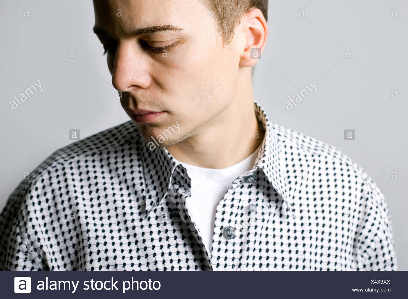young man,sad,looking down - Stock Image