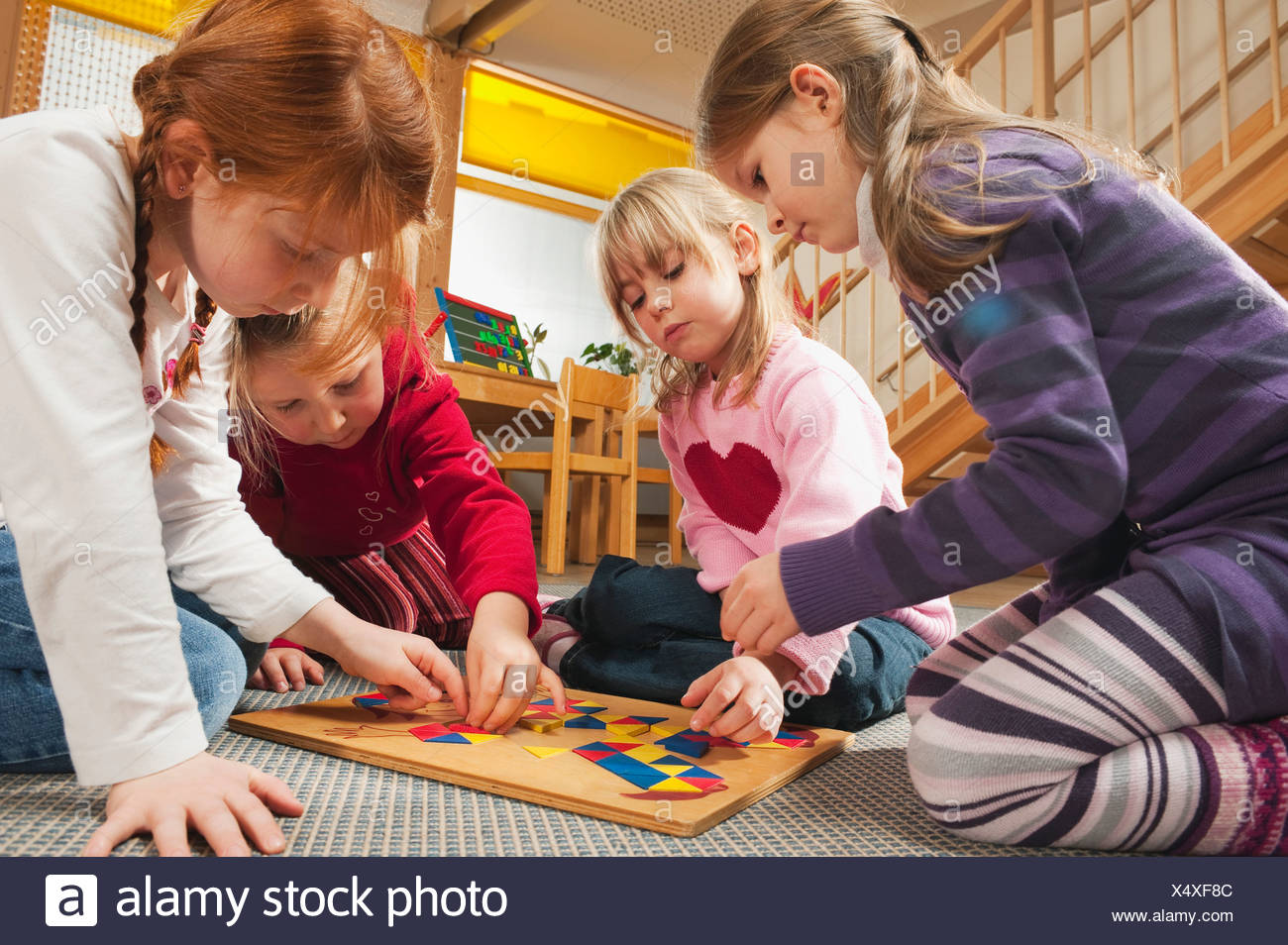 Germany, Children in nursery playing a learning game together, close-up Stock Photo