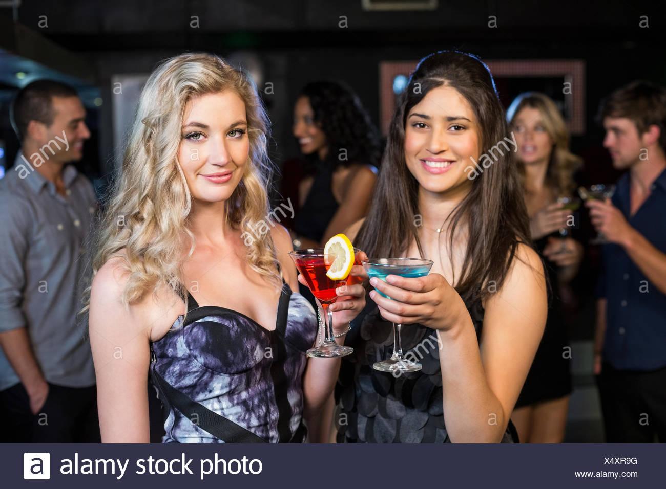 Portrait of friends having a drink - Stock Image