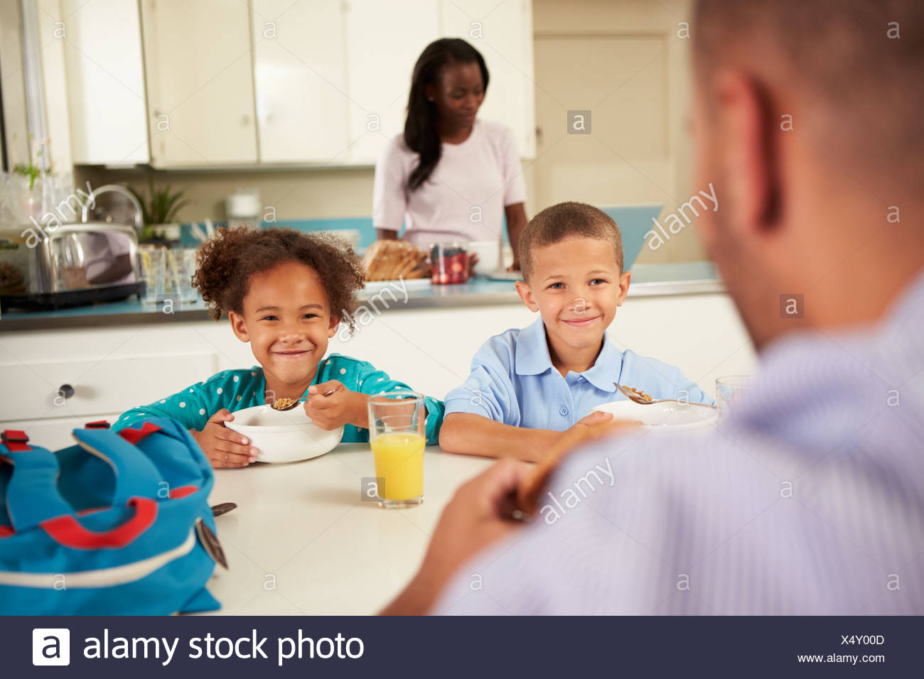 Family Eating Breakfast At Home Together - Stock Image