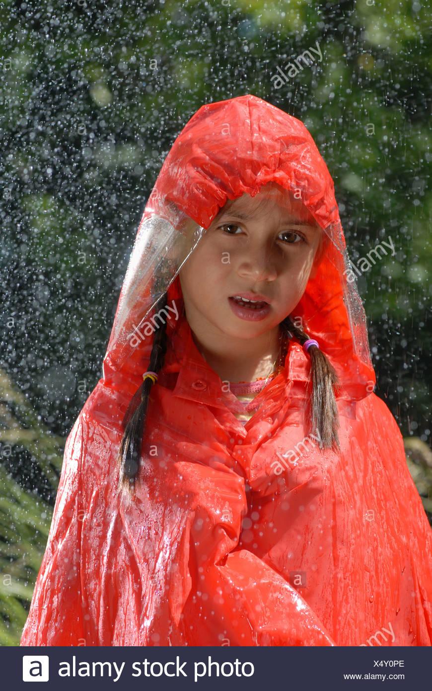 Rains, wetness, water, Autumn, fall, child, girl, orange, weather, rain protection - Stock Image