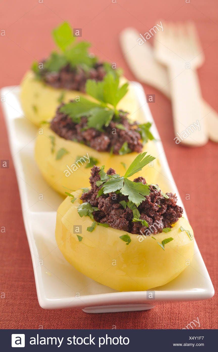 Potatoes stuffed with blood sausage - Stock Image