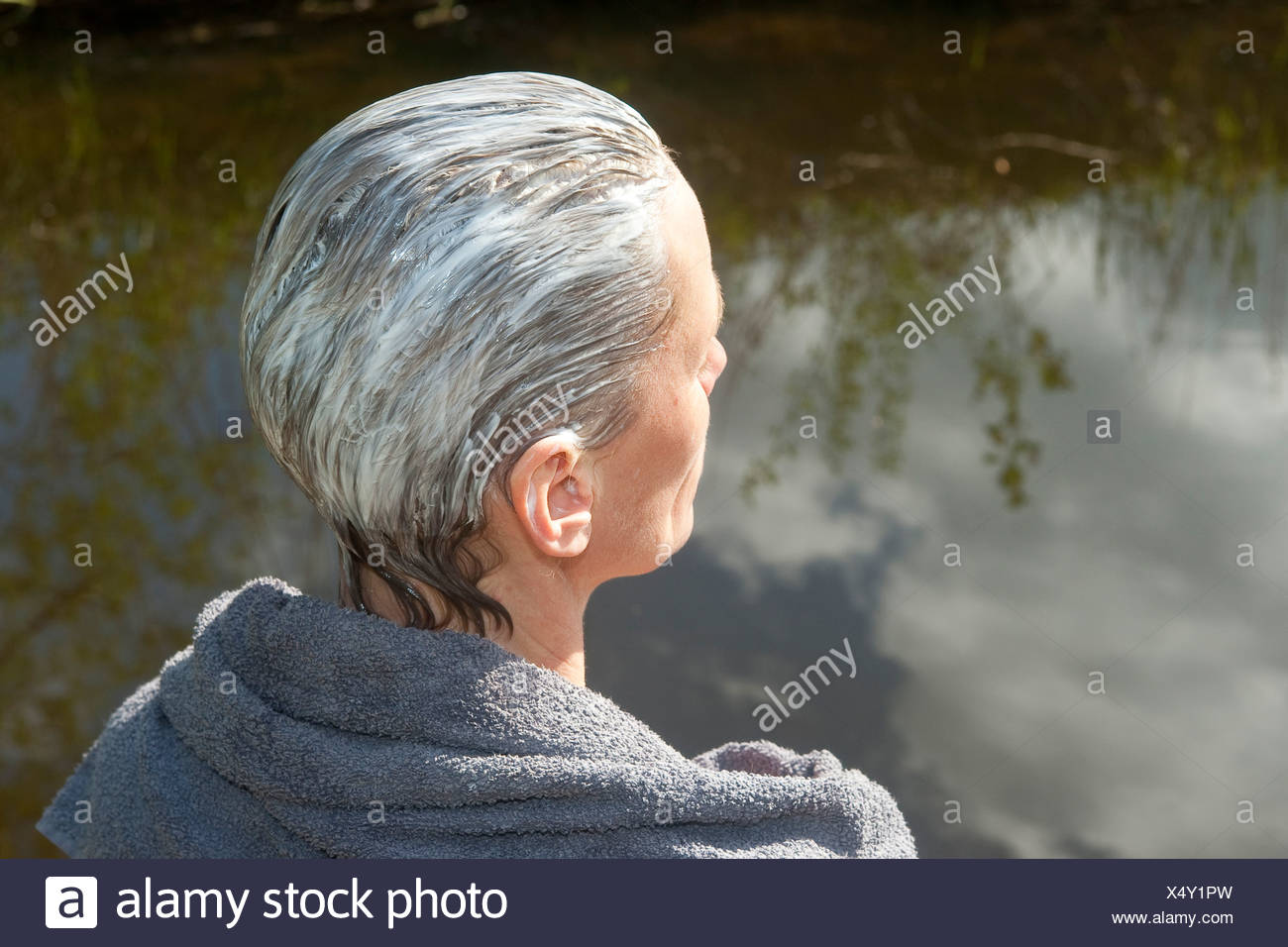 woman doing hair care with natural yoghourt in the hair - Stock Image