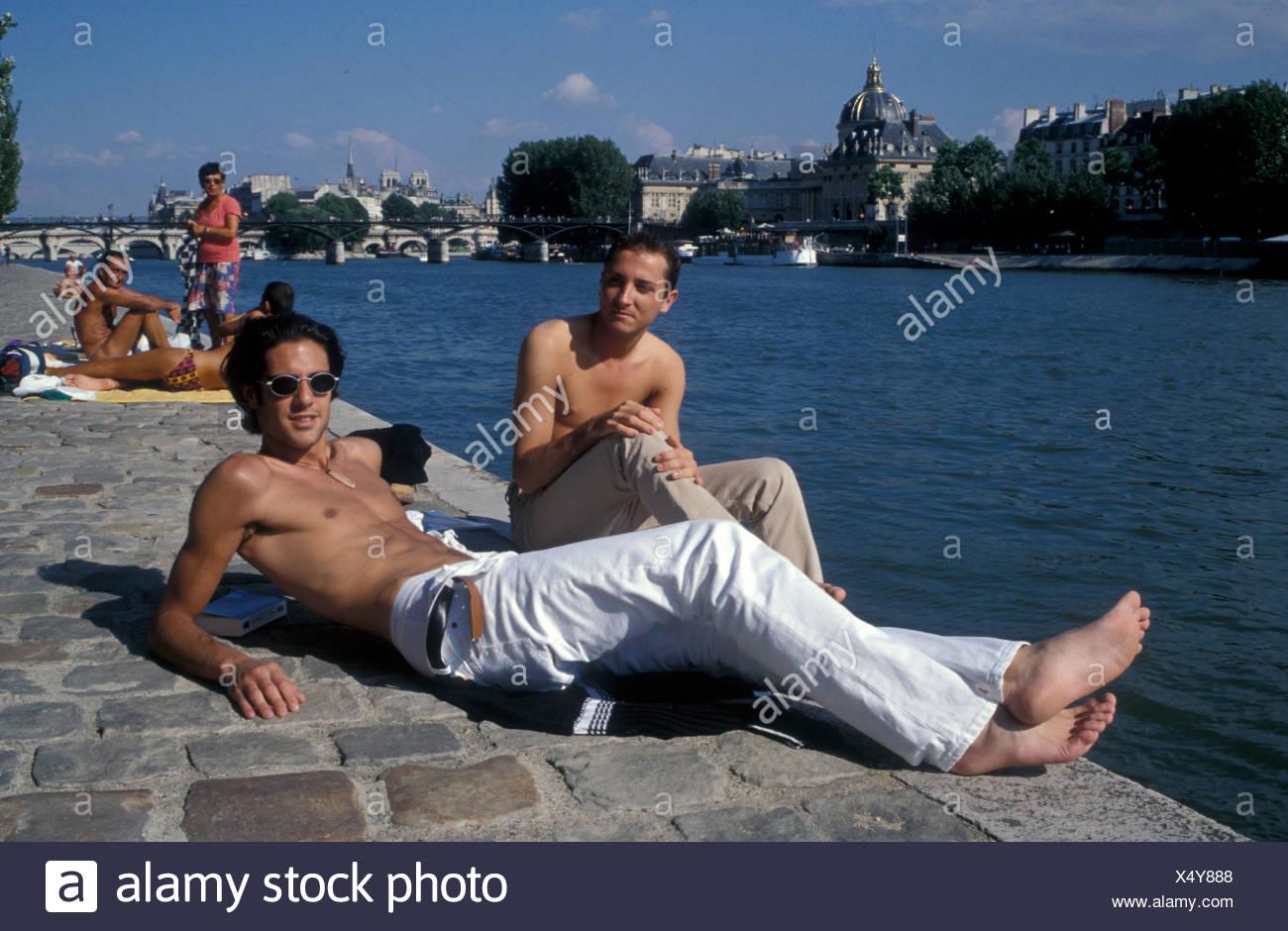 Gay Men Sunbathing On Tata Beach Next To River Seine Paris France 1997