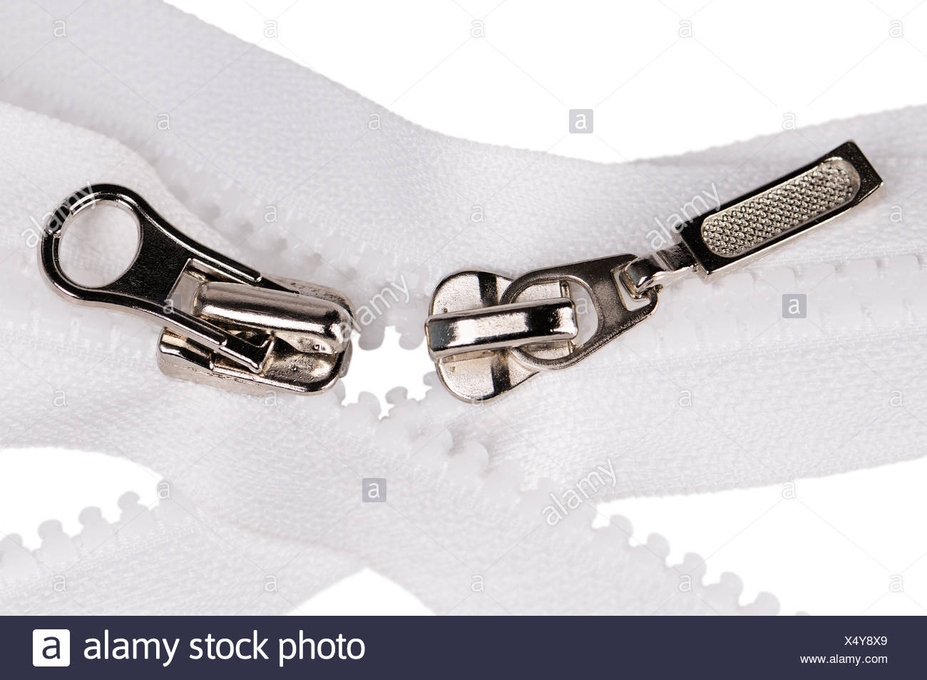 Two metal and plastic zipper fasteners isolated on the white - Stock Image