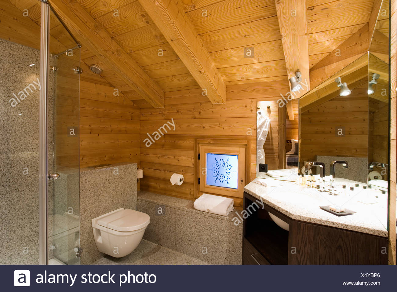 Wooden Ceiling And Walls In Alpine Chalet Bathroom Stock Photo