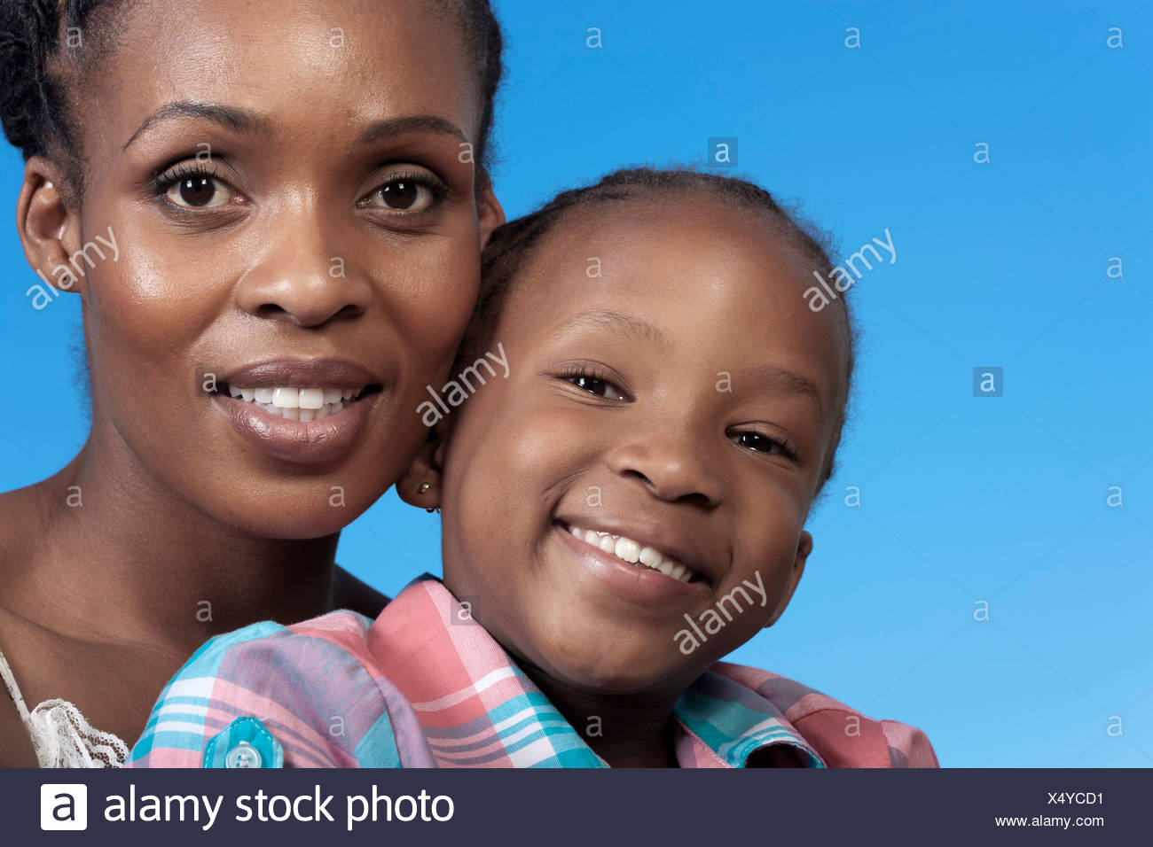 Closeup portrait of young African girl and her mother - Stock Image