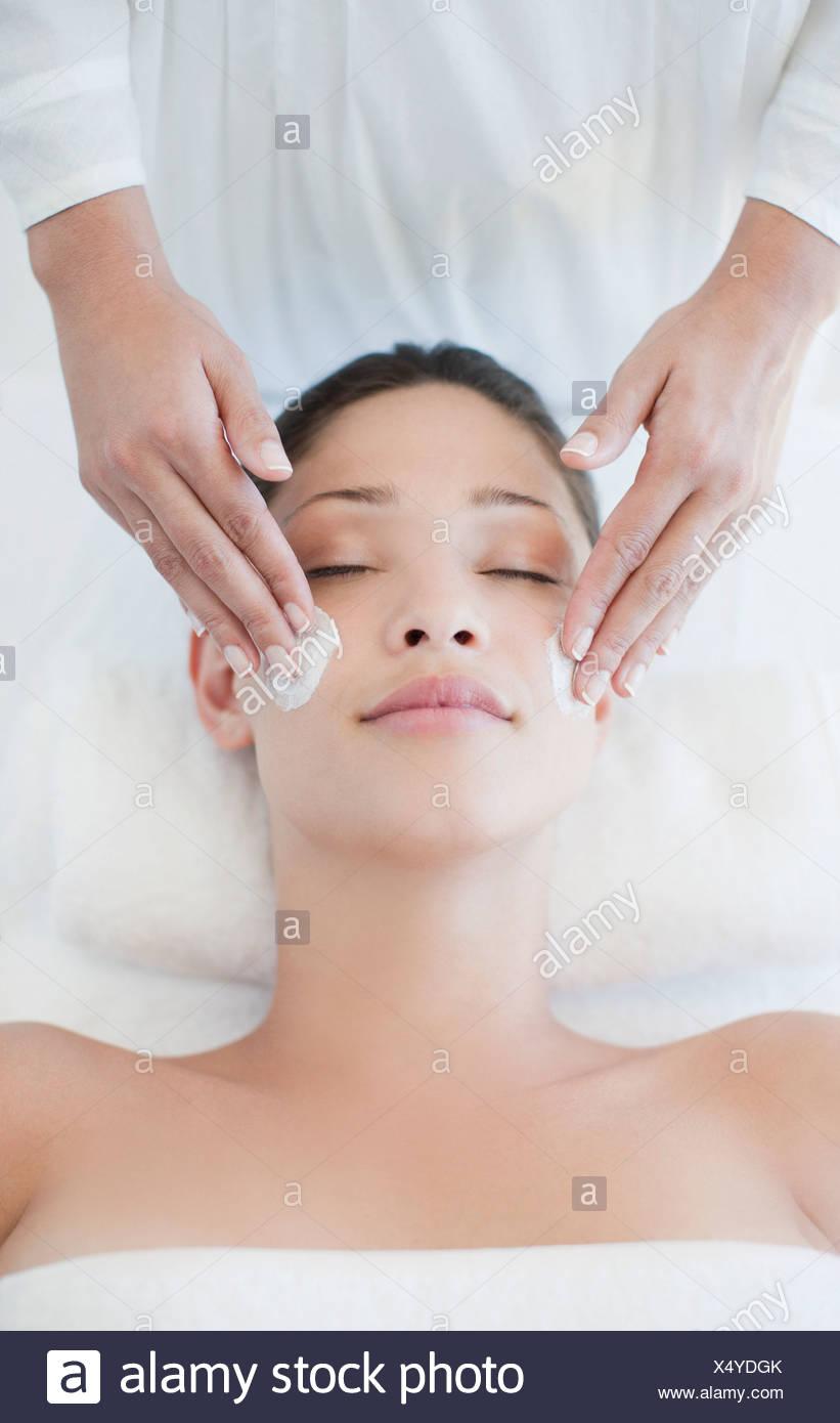 Woman receiving facial massage Stock Photo