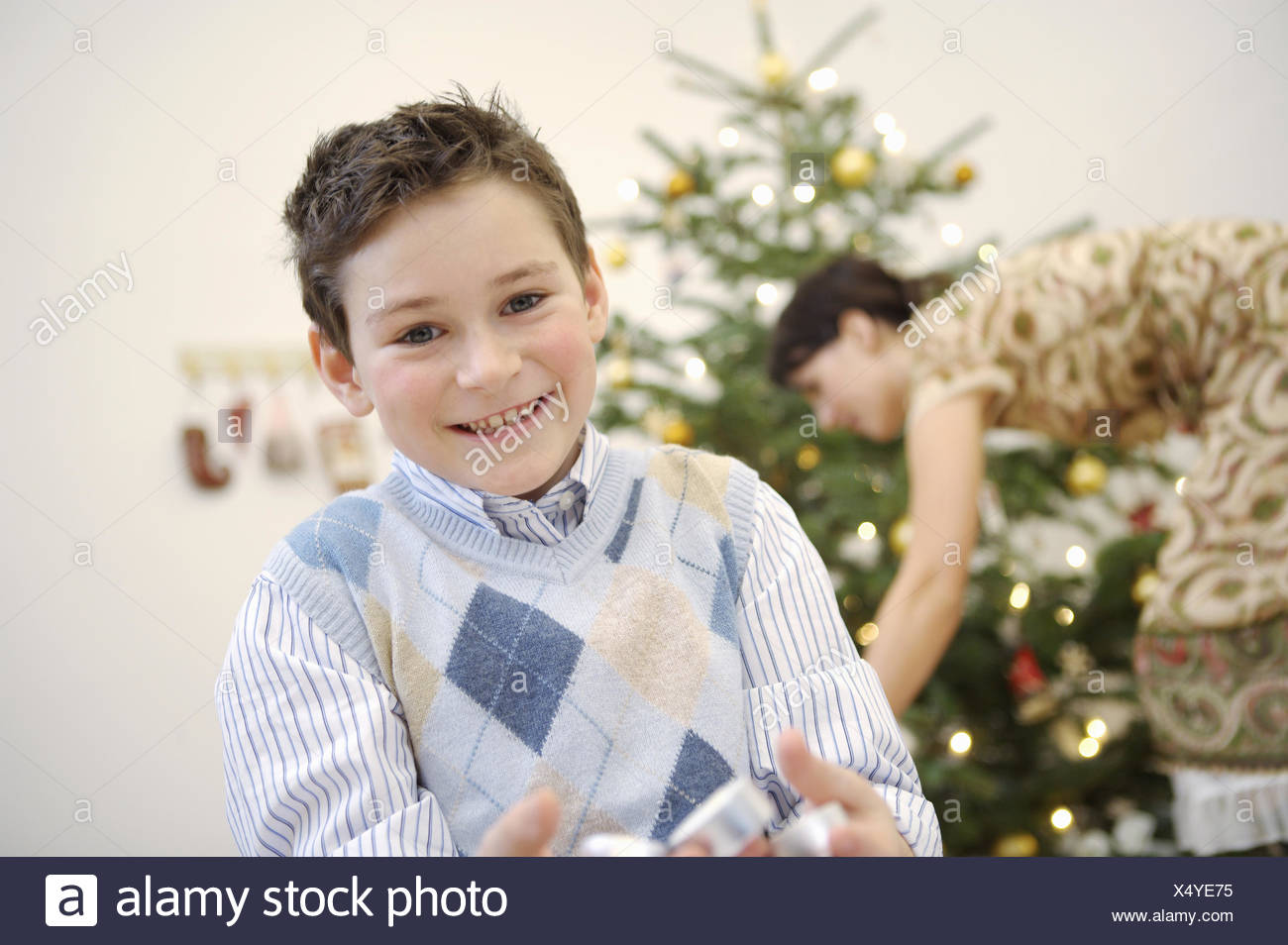 Boy smiling at Christmastime - Stock Image