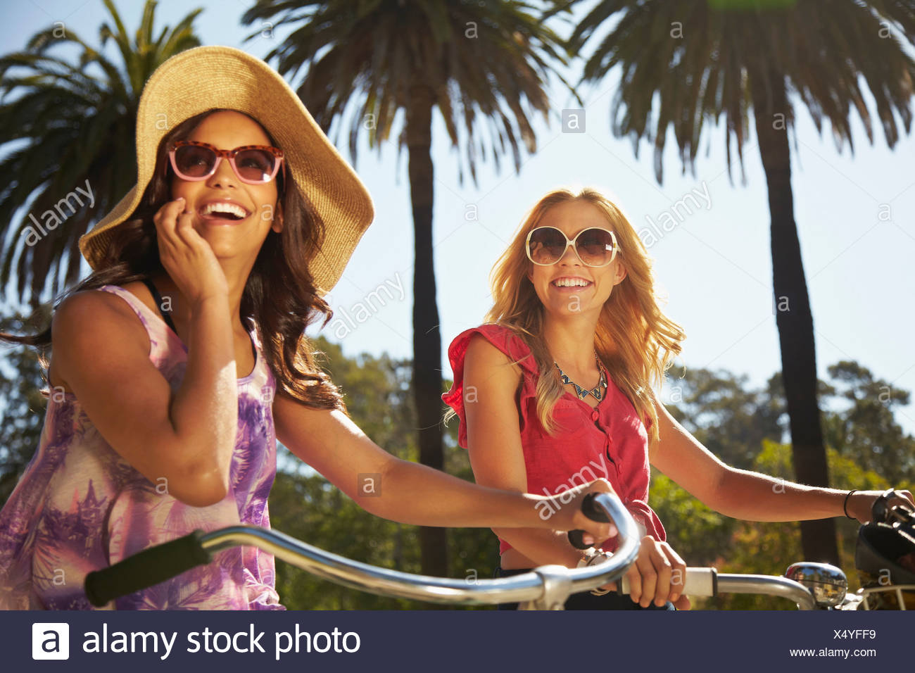 Women on bicycle laughing - Stock Image