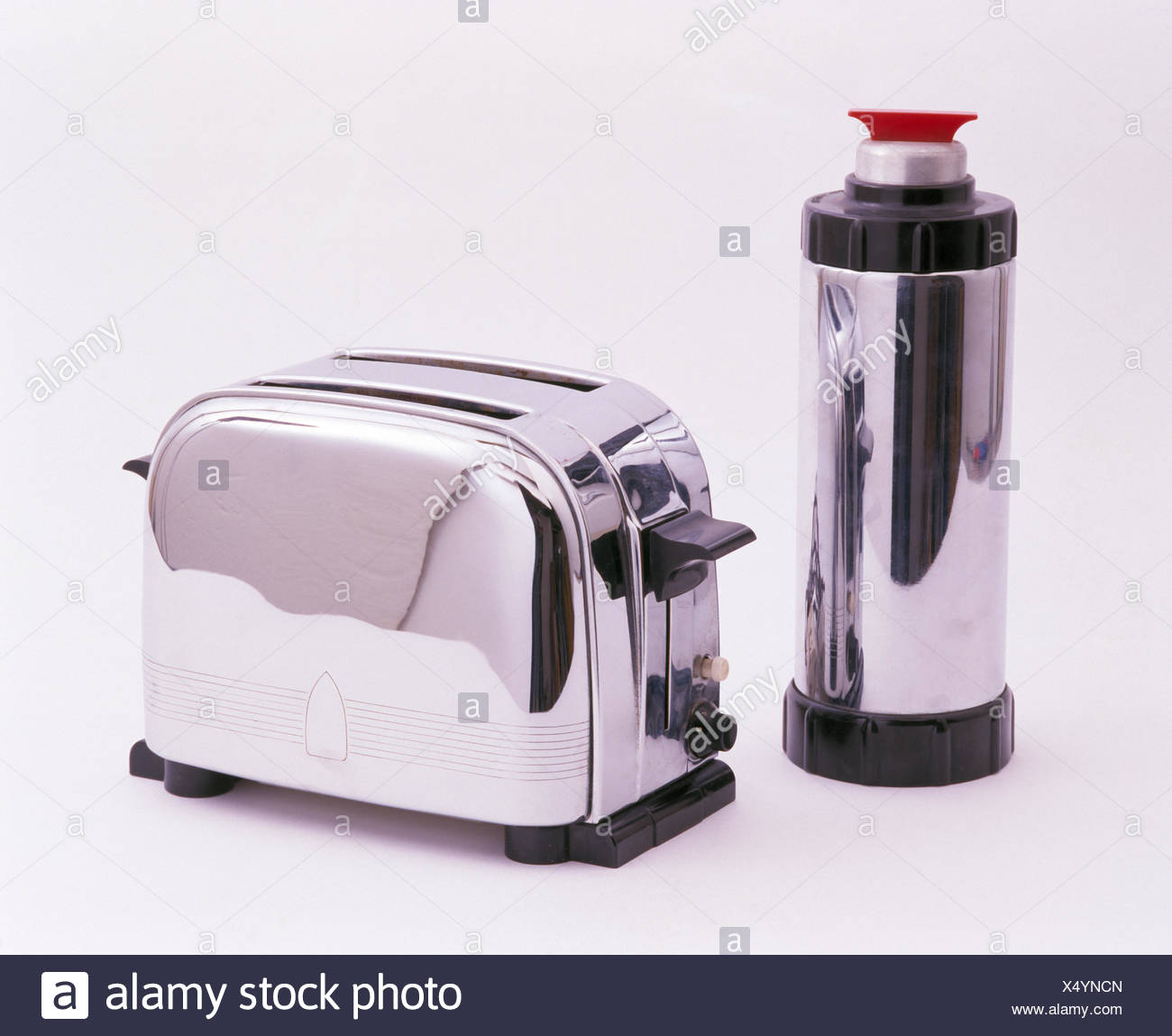 Close-up of stainless steel toaster and flask - Stock Image