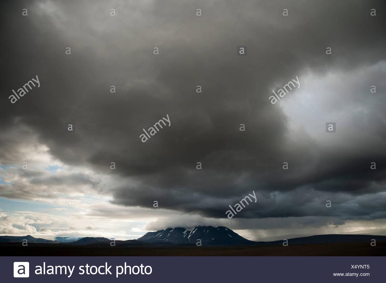 Bad weather, view towards snow-covered mountains and Langjoekull Glacier, highland slopes of Kjoelur or Kjalvegur, Highland - Stock Image