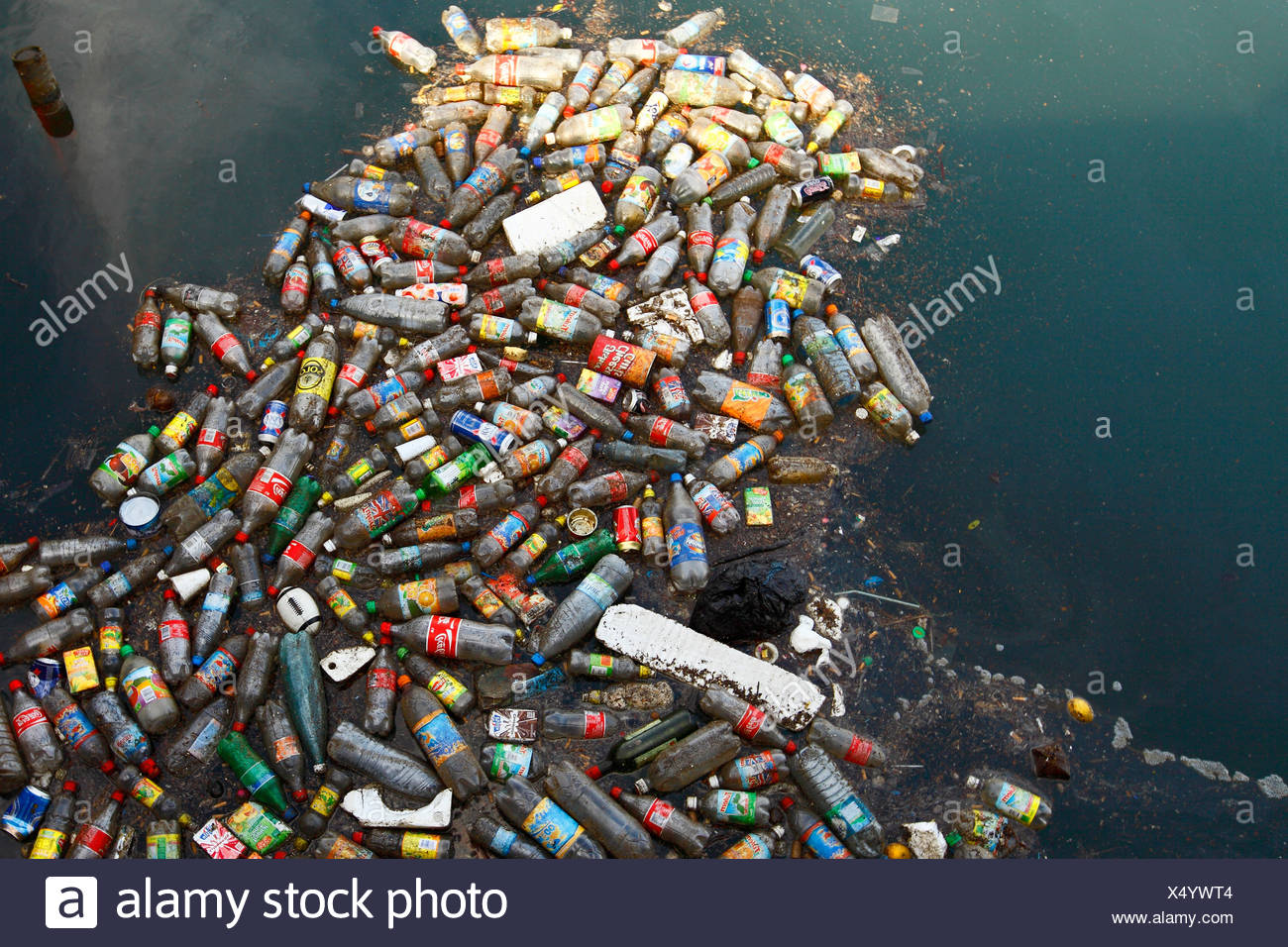 Plastic Bottle floating at the Baie de la Moselle in Noumea New caledonia. - Stock Image