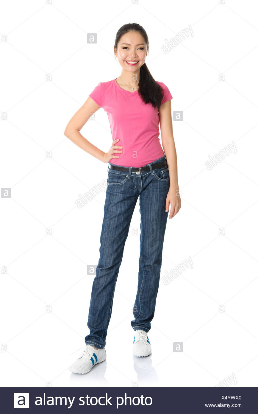 Full body asian teen girl with pink shirt and jeans standing isolated on white background