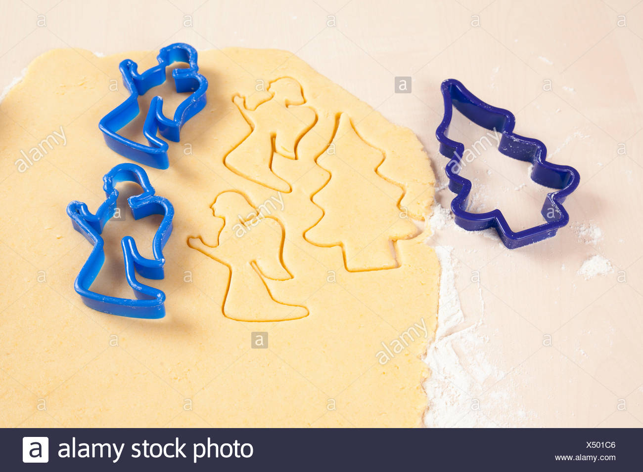 Christmas cookie cutters and dough - Stock Image