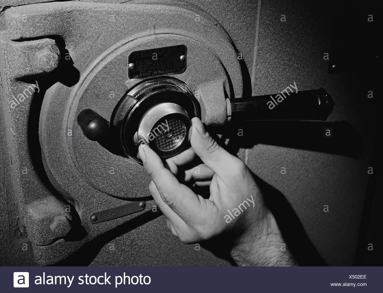 Mans hand unlocking safe - Stock Image
