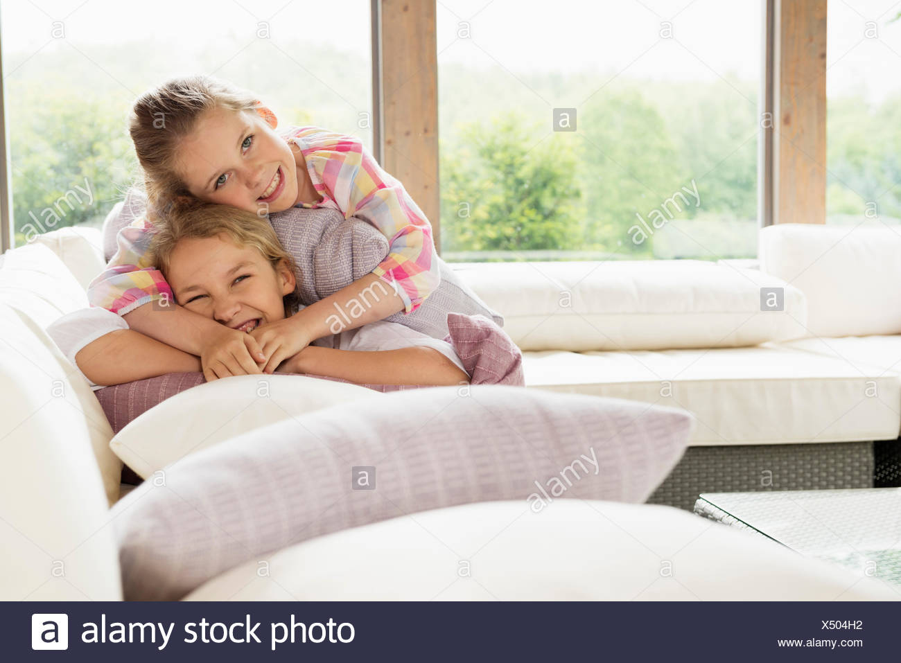 Two sisters smiling, portrait - Stock Image