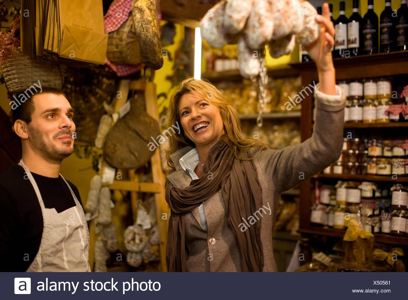 Vendor and customer in deli - Stock Image