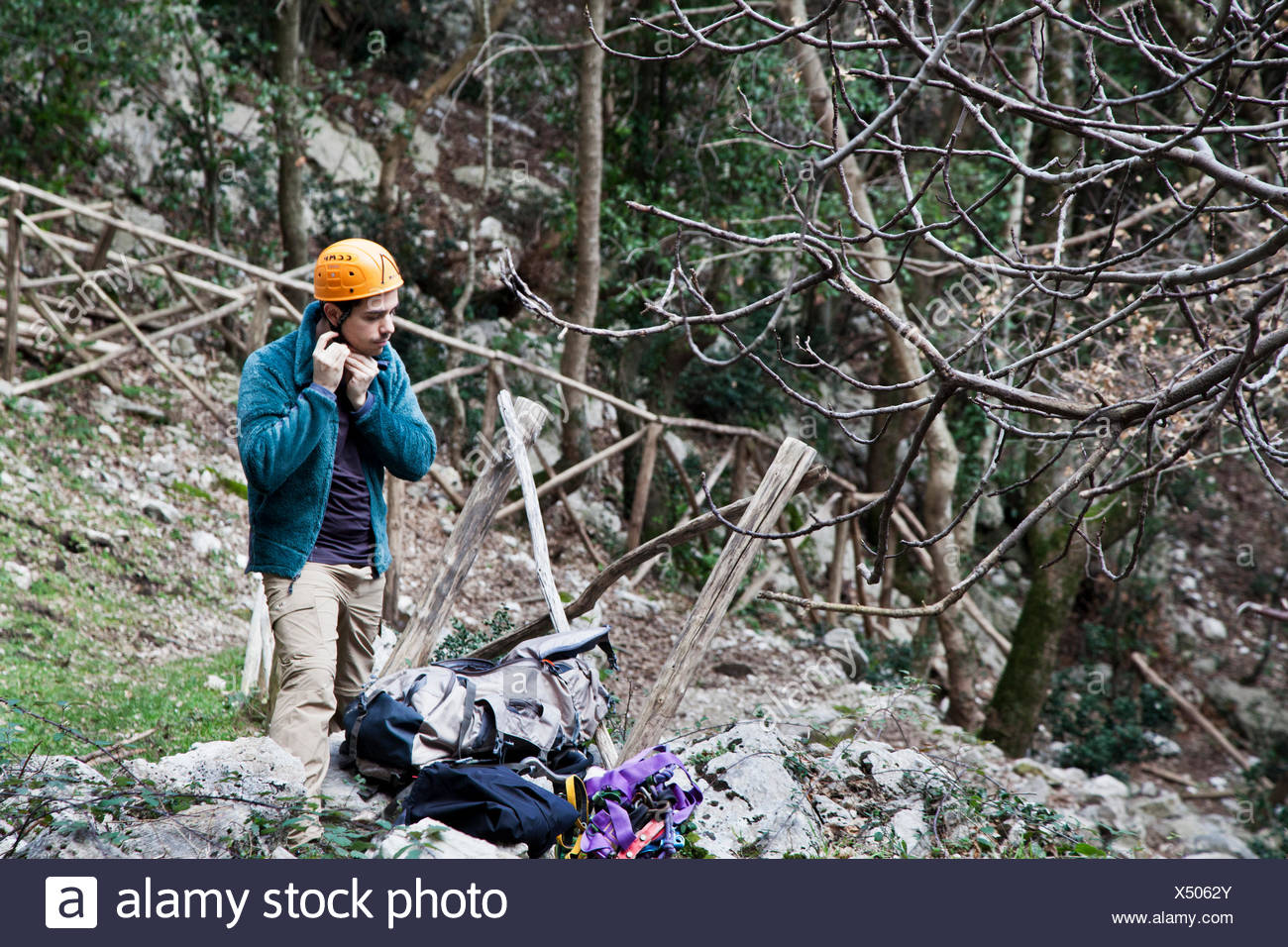 Italy, Lazio, Roccia, Man adjusting helmet before climbing - Stock Image