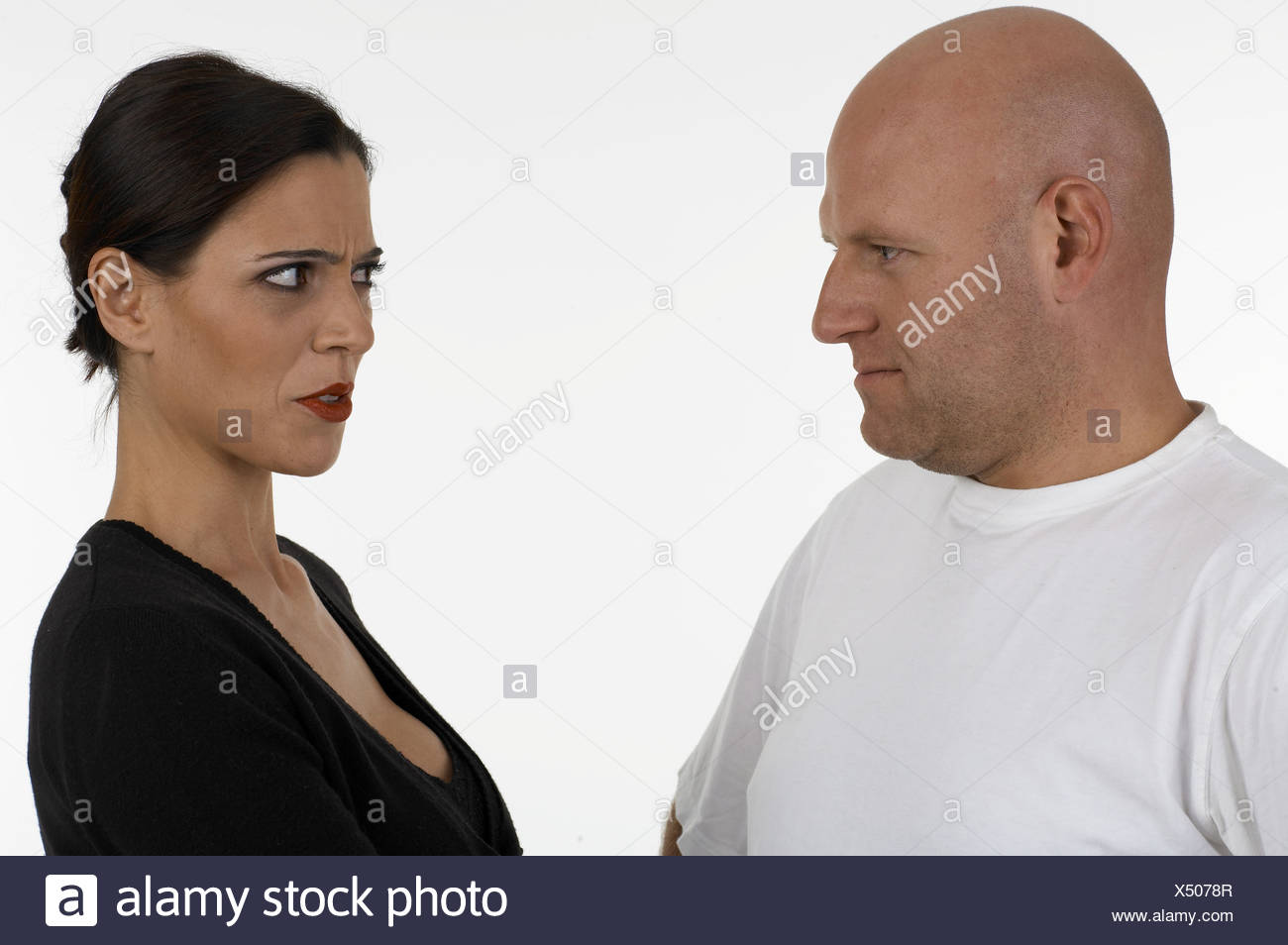 Woman remonstrate with a man - Stock Image