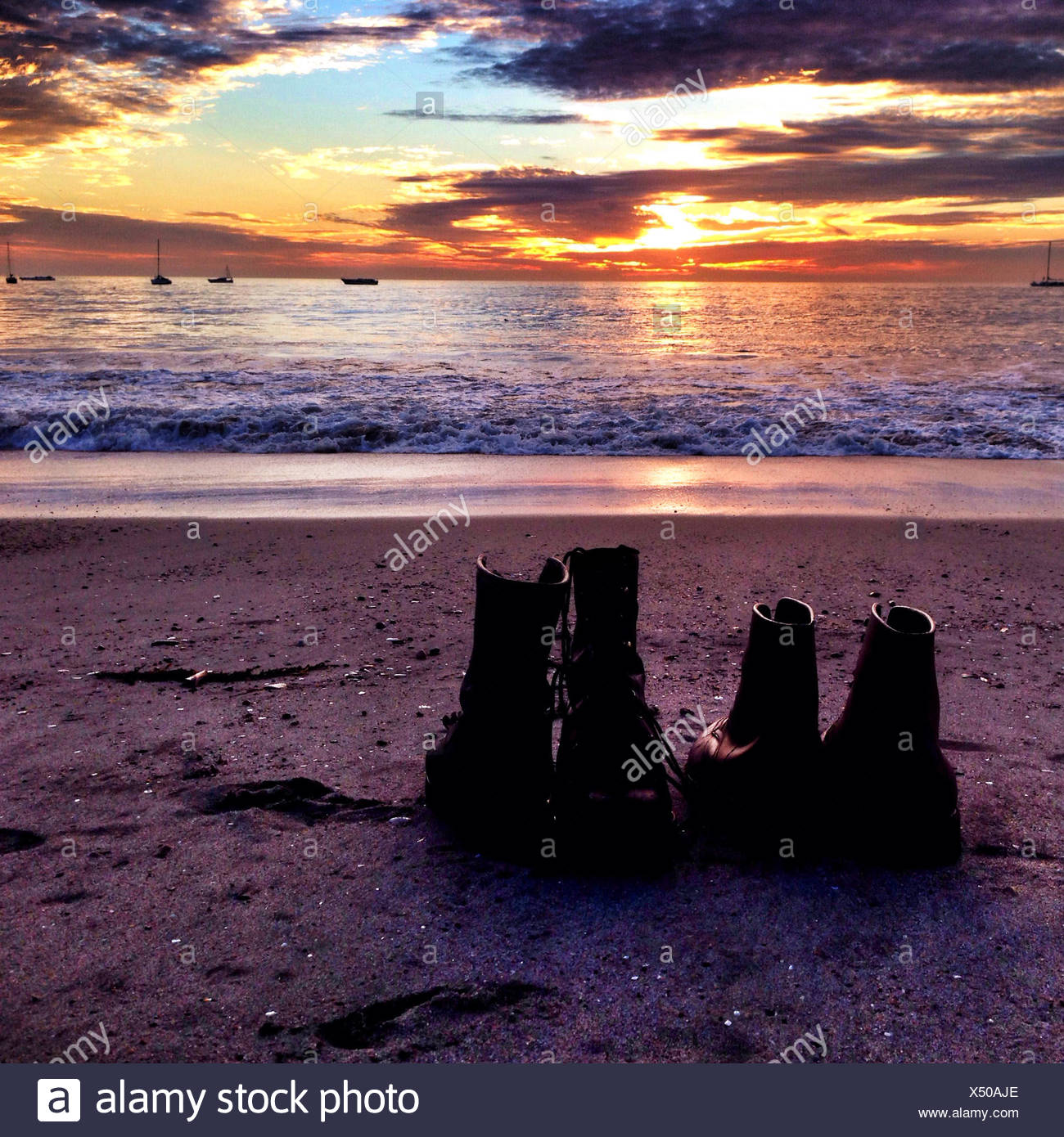 Shoes on beach - Stock Image
